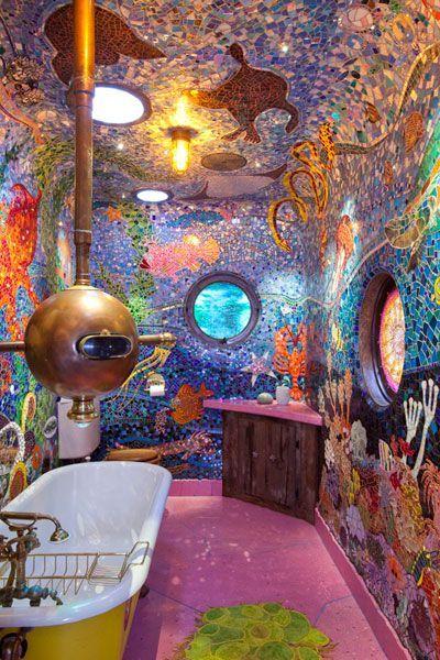 ocean bathoom, purple floor, mosaic tiles on ceiling wall depicts ocean, yellow tub, golden submarine tool, purple vanity