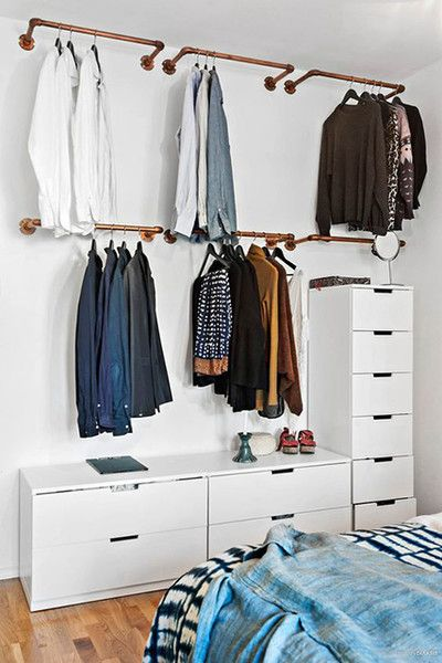 open closet in six different rails, white cabinets in L