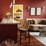 Open Room, Wooden Floor, Terracotta Wal, Brown Sofa, Round Coffee Table With Glass Top, Terracotta Island With White Marble, White Shair