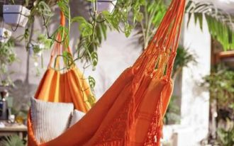 orange hammock on the patio with plants
