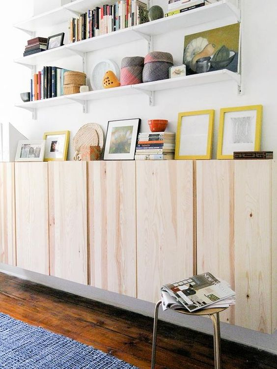 plain wooden floating cabinet with white floating shelves, white walls, wooden floor