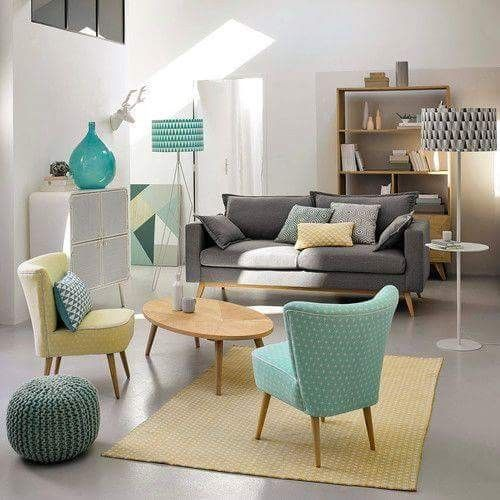 polkadot green and blue chair with round coffee table, grey sofa, polkadot rugs, ottoman, white wall, white cabinet