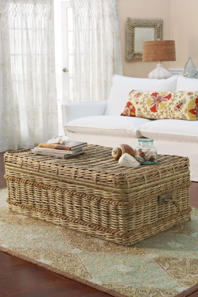 rattan box with sotrage inside, rug, wooden floor, white sofa, white curtain