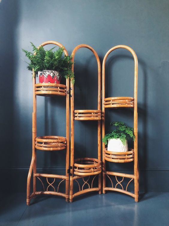 rattan room divider with round shelves for plants