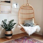 Rattan Swing With Pillows And Fur Blanket, Wooden Floor, Rug, White Wall, Plants,