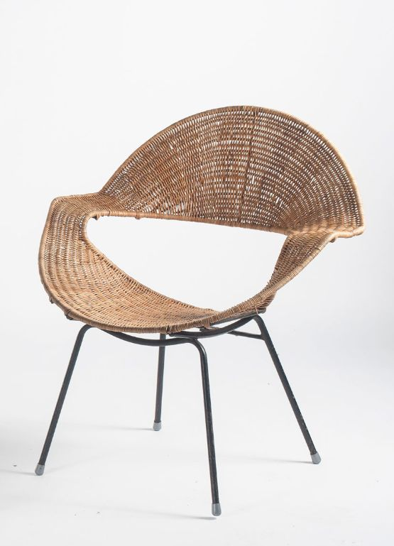 rattan woven chair with empty hole in the bottom back, black legs