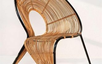 rattan woven chair with fluid line design