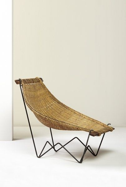 rattan woven lounge chair with black lines metal legs