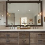 Rustic Bathroom Vanities With Tops Shower Fixtures Wide Wooden Framed Wall Mirror Glass Pendant Lamps Sinks Glass Shower Doors Caesarstone Countertop