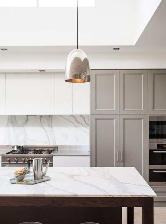 silver pendants, white marble island top, white marble backsplash, white ceiling, white cabinet