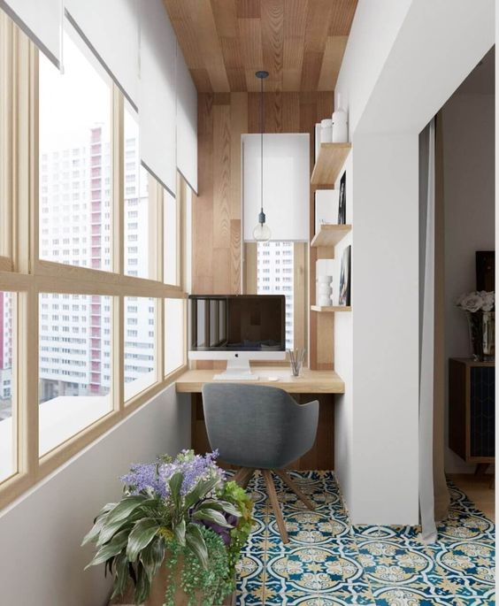 small balcony, patterned floor tiles, white wall, wooden covered wall and ceiling, wooden framed glass window, white chade, floating shelves, floating table, grey chair