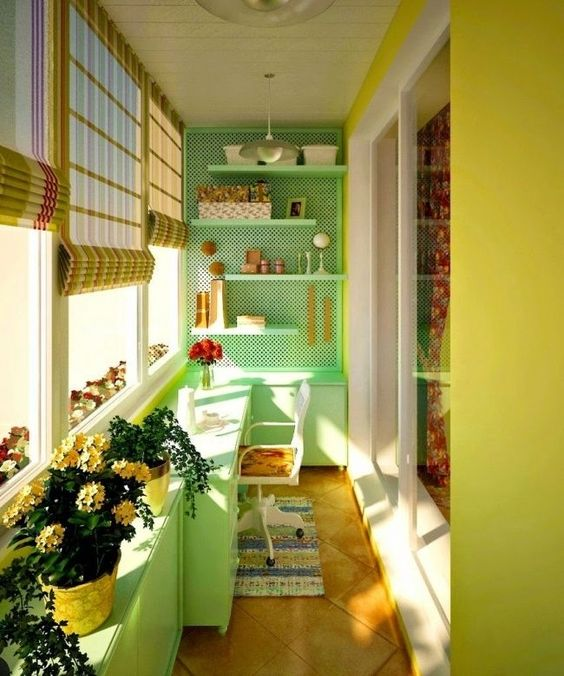 small balcony, wooden floor, green lime accent wall, peg boards, floating shelves, table, white chair, green cabinet, stick shade