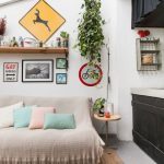 Small Living Room, Grey Tiles Floor, White Wall, Sofa Covered With Blanket, Pillows, Rattan Rug, Glass Sloping Ceiling