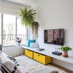 Small Living Room, Wooden Floor, White Rug, Grey Sofa, White Floating Cabinet Under TV, Plants, Yellow Wooden Box, Windows, Roman Shade