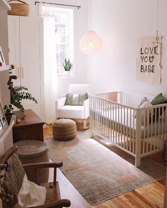 small nursery, white wall, white curtain, white cupboard, wooden floor, wooden chair, wooden cabinet