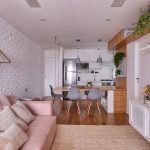 Small Open Room, Wooden Floor, White Open Brick Wall, White Cabinet, Brown Rug, Pink Sofa, Floating Shelves