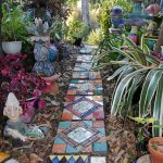 Small Pathway With Colorful Mosaic Tiles In One Line, Colorful Small Statues, Plants