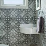 Small Powder Room, Wooden Floor, Tiny Geomteric Patterned Wallpaper, White Corner Sink, White Framed Small Mirror, White Toilet