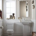 Small Power Room, Wooden Chevron Floor, Chevron Red Rug, White Wainscoting, Wallpaper, Chandelier, White Toile, White Sink