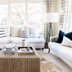 Square Rattan Coffee Table, Rug, White Sofa, White Floor Lamp, White Wall, Pillows, Plaid Curtain