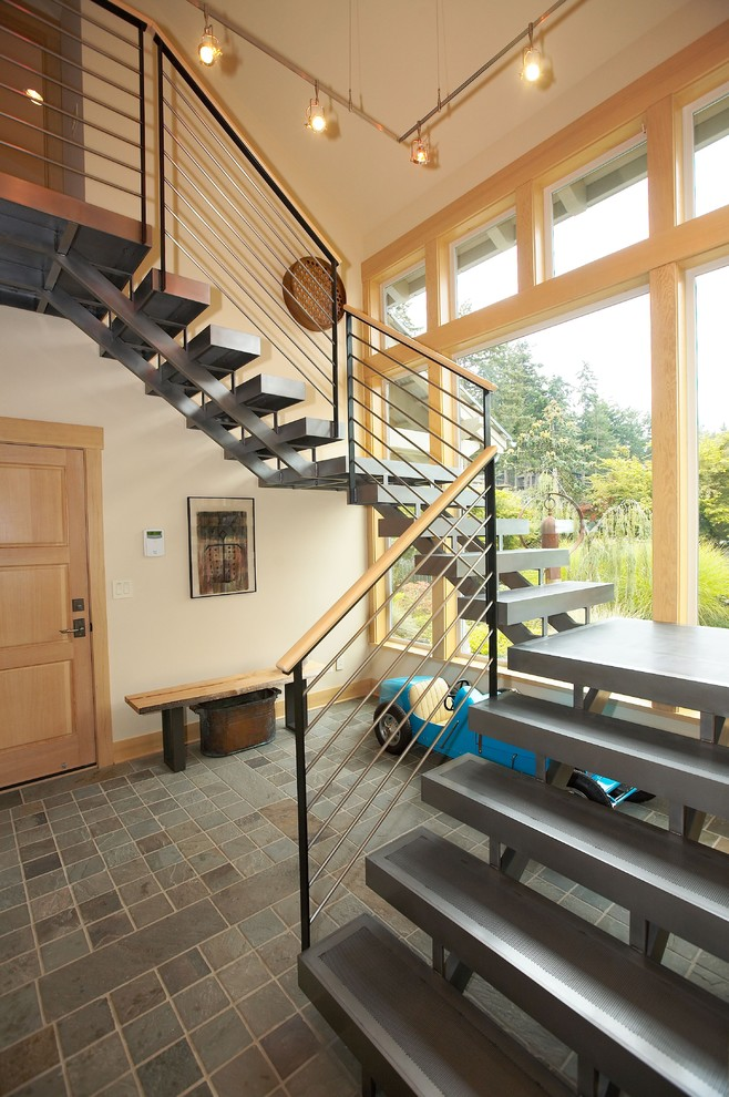steel stair detail wooden door steel stairs wooden cap cable railing wooden framed glass windows wooden bench wall decoration steel steps