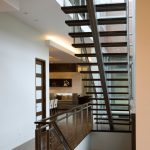 Steel Stair Detail Wooden Steps Steel Stair Cap Wire Cable Railing Wooden Floor White Walls Recessed Lighting Glass Windows Frosted Glass Doors