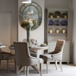 Studded Dining Chair Wall Mirrr Big Glass Flower Vase Wooden Cabinet Shelves Area Rug Round Wooden Dining Table Tufted Chairs