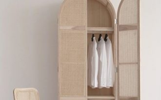 tall rattan cupboard with curvy top, drawers below