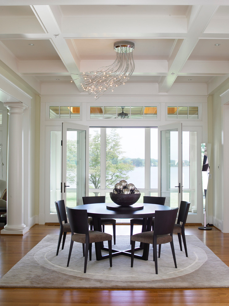 unique ceiling chandelier black wooden round dining table black dining chairs area rug wooden floor white ceiling glass windows and doors