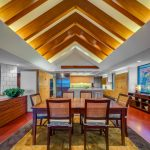 Unique Ceiling Wooden Beams Vaulted Ceiling Wooden Dining Table Wooden Chairs Colorful Floor Tiles Artowork Wooden Console