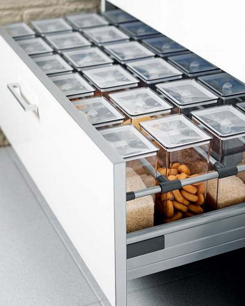 white drawers with shelves inside and clear jars for ingredients