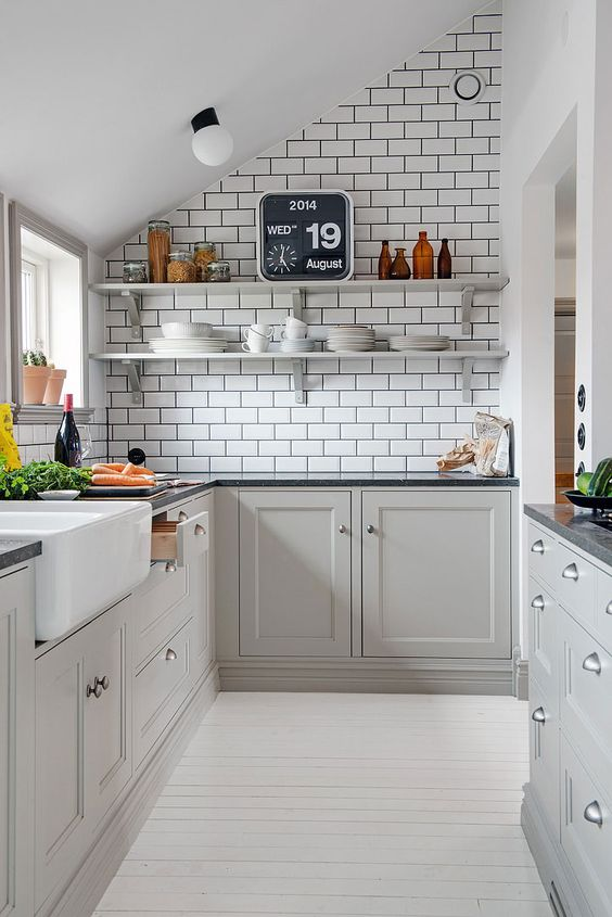 white kitchen, white wooden floor, white wall, white subway tiles, white ceiling, light grey cabinet, black marble