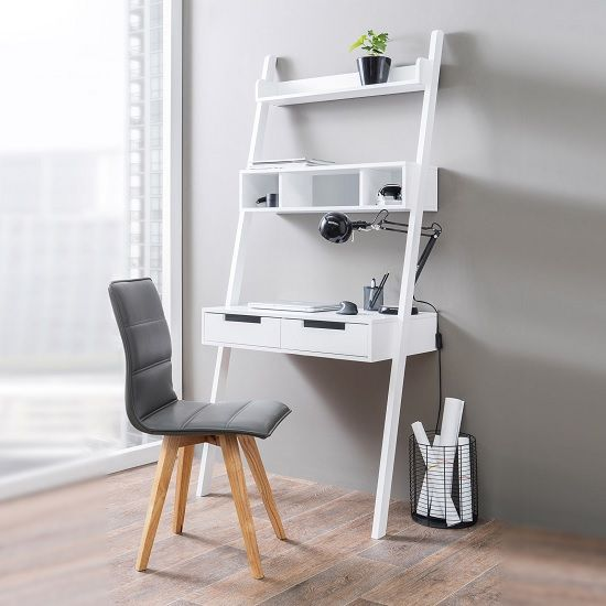 white ladder shelves table, lean on grey wall, grey chair with wooden legs, black round wire basket, wooden floor