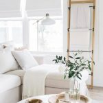 White Living Room, Wooden Floor, White Wall, White Shade Window, Wooden Rack, White Sofa, Wooden Round Coffe Table
