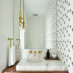 White Powder Room With Accent Wall On The Side, White Marble Backsplash, White Marble Top, Wooden Floating Support, Long Lined Small Golden Pendant, Golden Lines