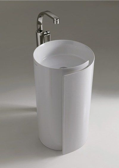 white round sink shaped like paper rolls with silver faucet