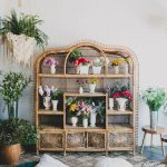 Wide Rattan Shelves With Detailed Patterns, Rug, Table, Chandelier, Flowers, Plants, Stools