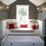 Window Nook With Arch Ceiling, Grey Top Half Wall, White Molding Wall, White Bench With Cushion, Sliding Bed Under