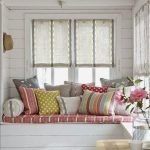 Window Nook With Wooden Bench, Pink Cushion, Pillows, White Wooden Wall, White Wooden Ceiling, Windows With Shade