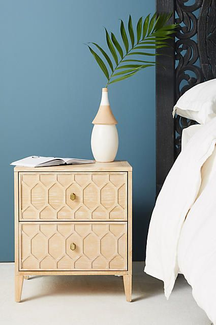 wooden bedside cabinet with honeycomb pattern craved