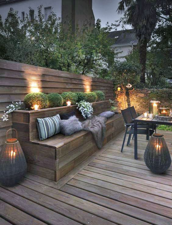 wooden deck, built in wooden bench, dining table set, wooden plank, LED on the bushes, candles