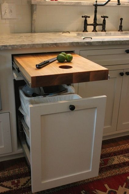 wooden extendable table, under marble kitchen top, white wooden cabinet with storage inside