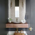 Wooden Floating Vanity, Grey Wall, Accent Wall, Small Thing Brown Sink, Wooden Floor, Thin Long Pendant, Tall Mirror
