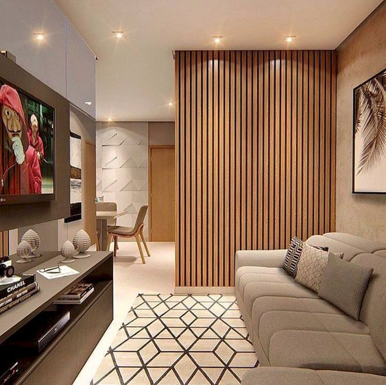 wooden slats partition, beige sofa, beige floor, rug, wooden cabinet, TV, beige wall