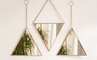 a set of 3 triangle mirrors arrange like puzzle