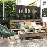 Backyard Corner, Wooden Floor, Crate Bench, Pillows, Plants, Black Wooden Fence, Crate Coffee Table, Comfort Chair