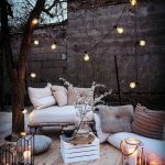 Backyard Corner, Wooden Floor, Wooden Bench With White Cushion, White Cushion On The Floor, White Crate Box, Ottoman, Lamps, Pillows