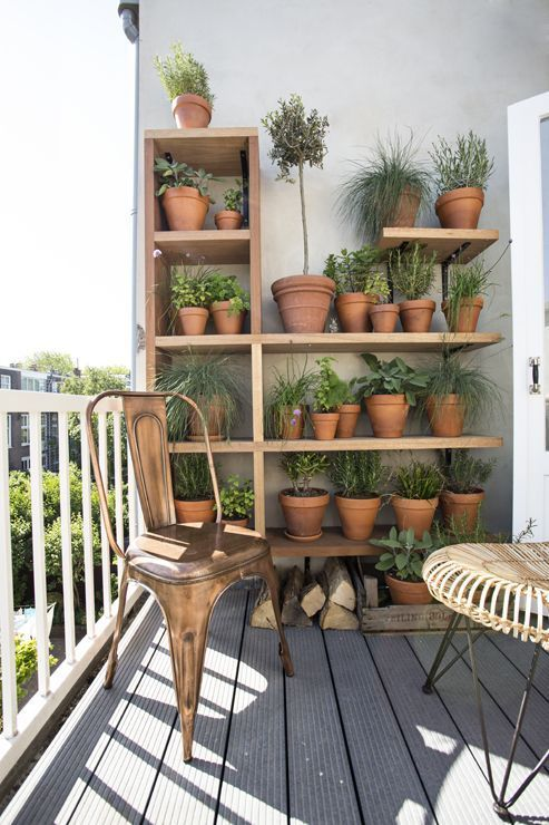 balcony with wooden shelves, wooden floating shelves, plank floor, industrial chair, rattan table