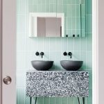 Bathroom, Green Wall Tiles, Black Marble Vanity With Two Black Bowl Sink, Patterned Floor Tiles, Mirror