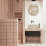 Bathroom, Pink Square Tiles On The Vanity, Wall In The Shower Are And Partition, White Toilet, Terrazzo Floor, White Wall, White Sink, Round Mirror